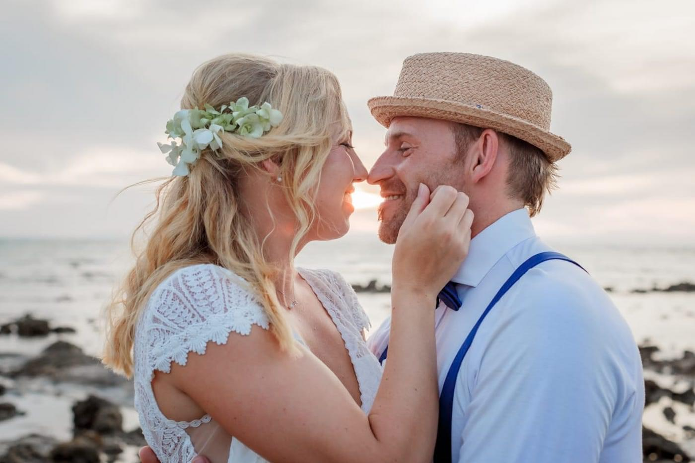 Bride and groom smiling on beach